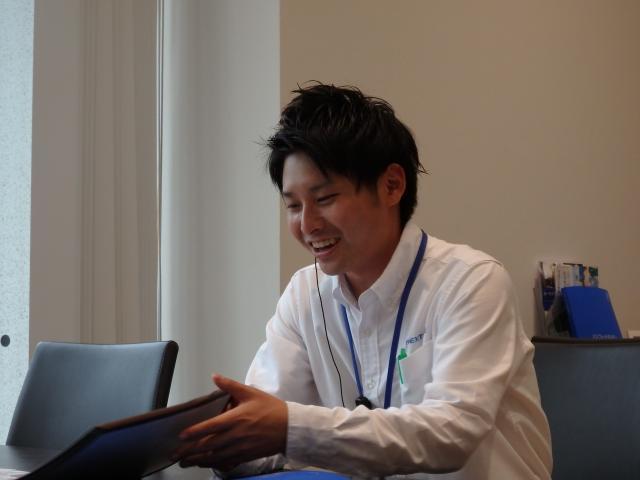 ネクステージのスタッフ写真 カーライフアドバイザー 飯野 祐太郎